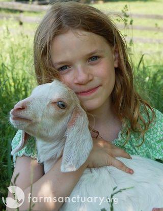 Farm Sanctuary_girl with goat